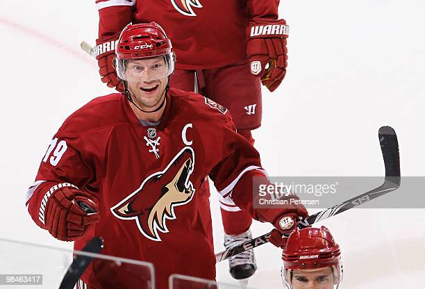 Shane Doan of the Phoenix Coyotes celebrates with teammates after Keith Yandle scored a first period goal against the Detroit Red Wings in Game One...