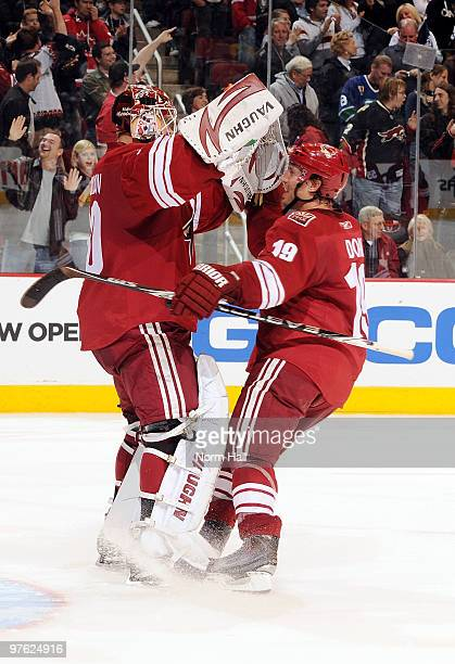 Shane Doan of the Phoenix Coyotes congratulates teammate Ilya Bryzgalov after a shootout victory over the Vancouver Canucks on March 10 2010 at...
