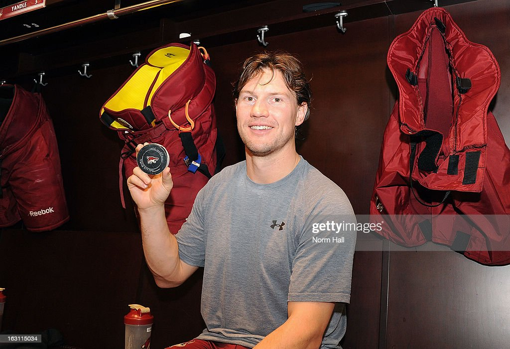 Shane Doan #19 of the Phoenix Coyotes displays the puck from his third period goal against the Anaheim Ducks at Jobing.com Arena on March 4, 2013 in Glendale, Arizona. It was Doan's 800th career point.