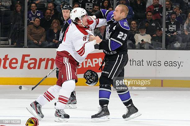 Shane Doan of the Phoenix Coyotes fights against Dustin Brown of the Los Angeles Kings at Staples Center on February 16 2012 in Los Angeles California