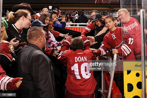 Shane Doan of the Phoenix Coyotes greets fans as he heads to the locker room after pregame warmups before facing the Nashville Predators at Jobingcom...