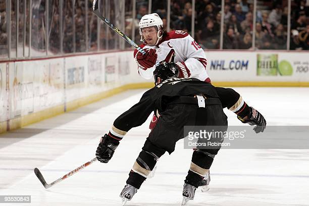 Shane Doan of the Phoenix Coyotes passes the puck against Nick Boynton of the Anaheim Ducks during the game on November 29 2009 at Honda Center in...