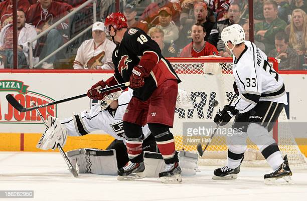 Shane Doan of the Phoenix Coyotes redirects the puck into the net for a goal past goalie Ben Scrivens and Willie Mitchell of the Los Angeles Kings...