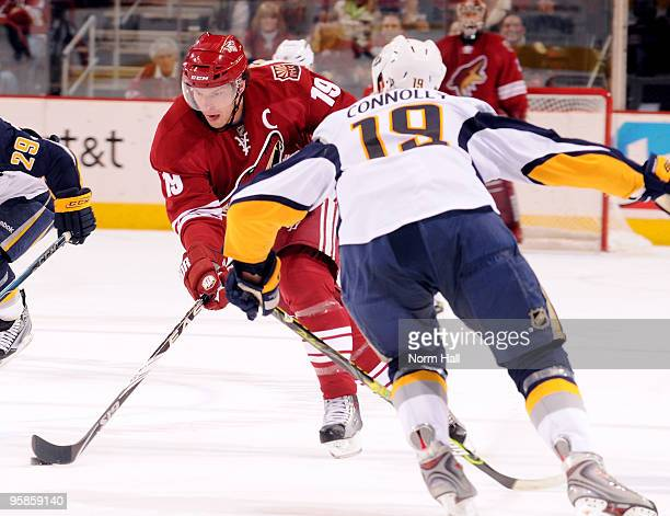 Shane Doan of the Phoenix Coyotes skates the puck up the ice against a defending Tim Connolly of the Buffalo Sabres on January 18 2010 at Jobingcom...