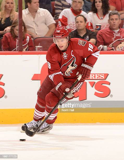 Shane Doan of the Phoenix Coyotes skates with the puck against the Detroit Red Wings at Jobingcom Arena on April 4 2013 in Glendale Arizona