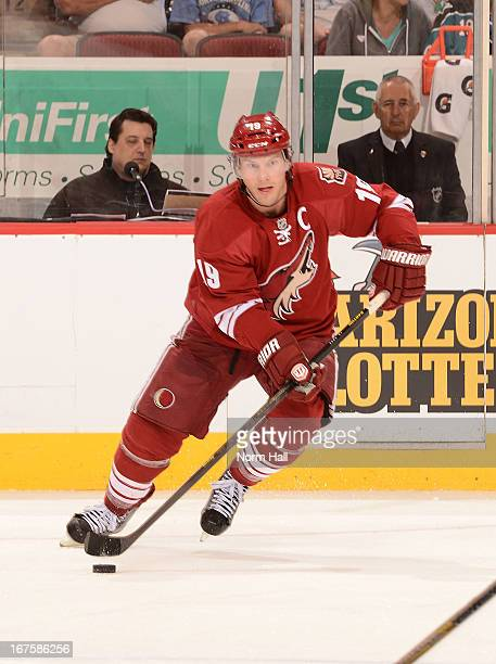 Shane Doan of the Phoenix Coyotes skates with the puck against the San Jose Sharks at Jobingcom Arena on April 24 2013 in Glendale Arizona