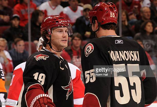 Shane Doan of the Phoenix Coyotes talks to teammate Ed Jovanovski during a time out against the Detroit Red Wings on January 2 2010 at Jobingcom...