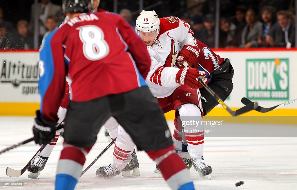 Shane Doan #19 of the Phoenix Coyotes tkes a shot against Jan Hejda #8 of the Colorado Avalanche at the Pepsi Center on February 11, 2013 in Denver, Colorado. The Coyotes defeated the Avalanche 3-2 in overtime.