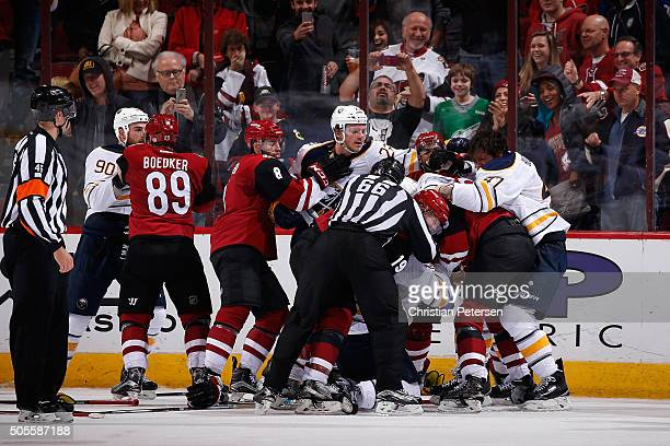Shane Doan Oliver EkmanLarsson and Anthony Duclair of the Arizona Coyotes come together in a post game scrum with Sam Reinhart and Zach Bogosian of...