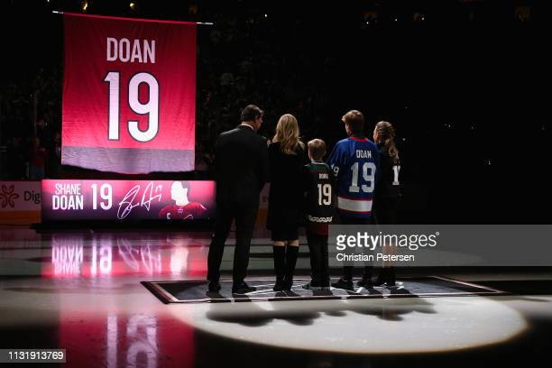 Shane Doan wife Andrea and kids Josh Carson and Karys observe as Doan 19 banner is raised during a pregame ceremony to honor Shane Doan and retire...
