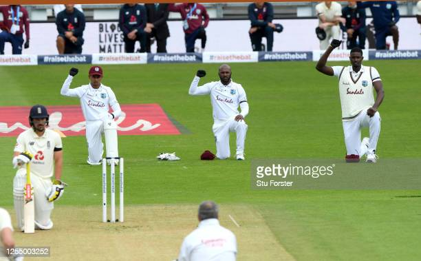 Shane Dowrich, Jermaine Blackwood and Jason Holder of the West Indies take a knee during day one of the 1st #RaiseTheBat Test match at The Ageas Bowl...