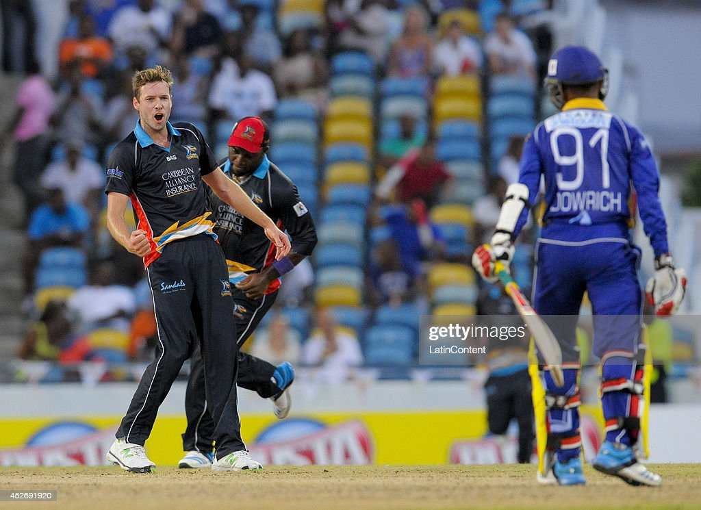 Shane Dowrich (R) of Barbados Tridents caught off Ben Laughlin (L) of Antigua Hawksbills during a match between Barbados Tridents and Antigua Hawksbills as part of the week 3 of Caribbean Premier League 2014 at Kensington Oval on July 25, 2014 in Bridgetown, Barbados.