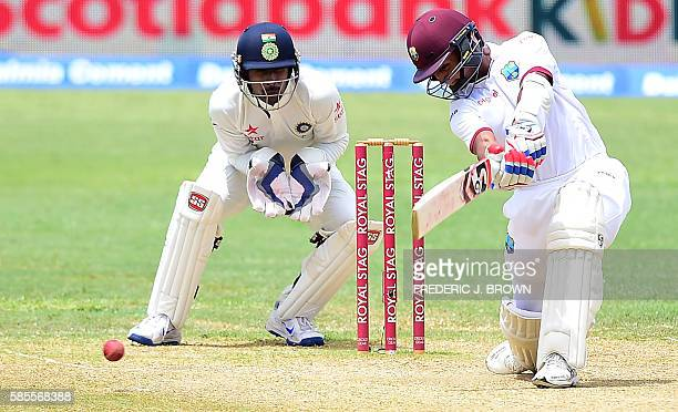 Shane Dowrich of the West Indies connects for a hit off a delivery from Mohammed Shami of India on day five of their Second Test cricket match on...