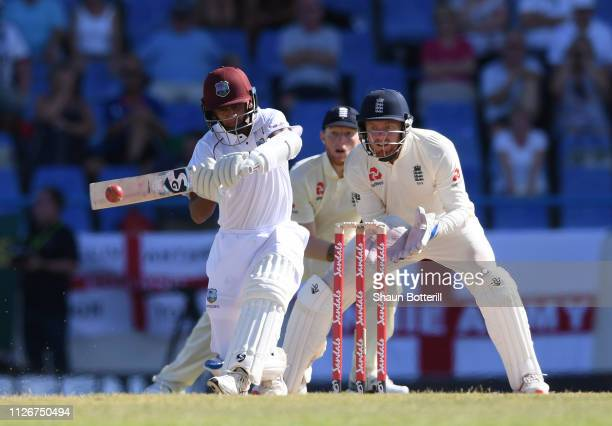 Shane Dowrich of West Indies plays a shot as wicket keeper Jonny Bairstow of England looks on during Day Two of the 2nd Test match between West...