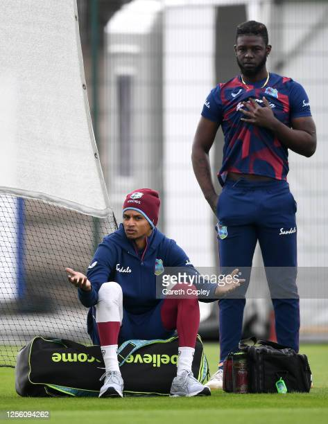 Shane Dowrich speaks to Sheyne Moseley of West Indies during a West Indies Nets Session at Emirates Old Trafford on July 14, 2020 in Manchester,...