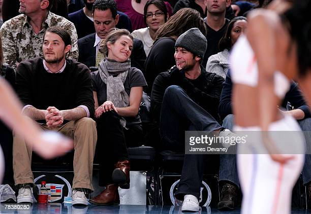 Shane Dreary Keri Russell and Chace Crawford attend Dallas Mavericks vs New York Knicks game at Madison Square Garden on December 10 2007 in New York...