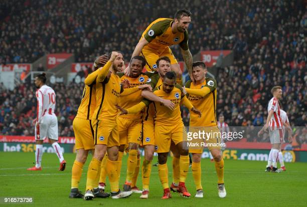 Shane Duffy joins in the celebrations with his teammates as Jose Izquierdo of Brighton and Hove Albion celebrates scoring his side's first goal...