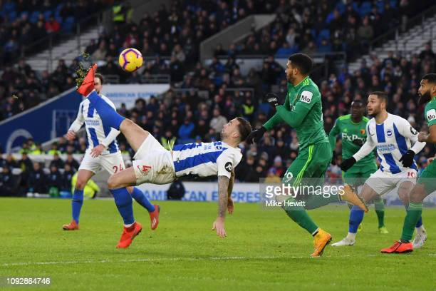 Shane Duffy of Brighton and Hove Albion attempts a over head kick as Etienne Capoue of Watford attempts to block during the Premier League match...