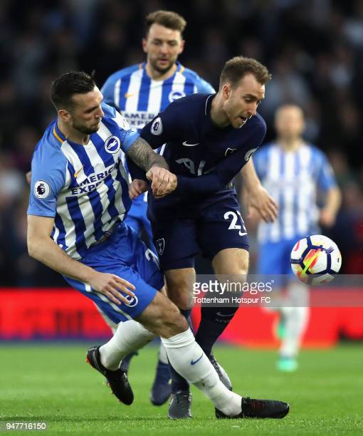 Shane Duffy of Brighton and Hove Albion battles for possesion with Christian Eriksen of Tottenham Hotspur during the Premier League match between...