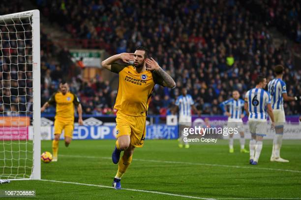 Shane Duffy of Brighton and Hove Albion celebrates after scoring his team's first goal during the Premier League match between Huddersfield Town and...