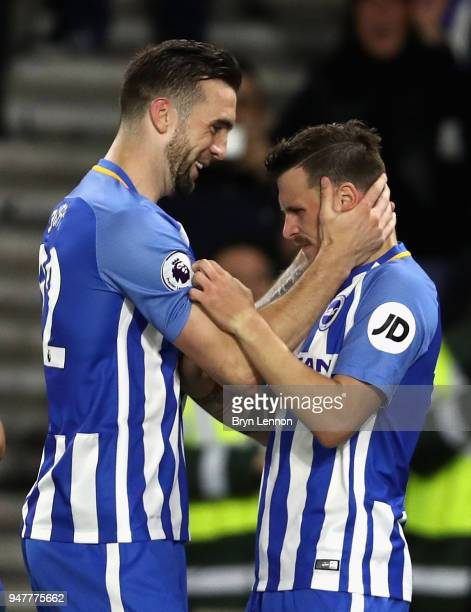 Shane Duffy of Brighton and Hove Albion celebrates with goal score Pascal Gross of Brighton and Hove Albion after he scores his sides first goal from...