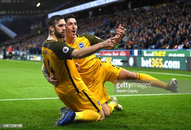Shane Duffy of Brighton and Hove Albion celebrates with teammate Lewis Dunk after scoring his team's first goal during the Premier League match...