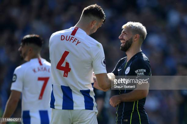 Shane Duffy of Brighton and Hove Albion congratulates Sergio Aguero of Manchester City following the Premier League match between Brighton & Hove...