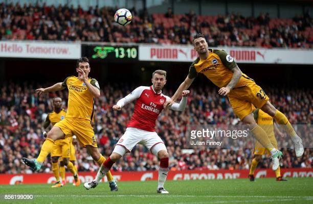 Shane Duffy of Brighton and Hove Albion headers the ball away from Aaron Ramsey of Arsenal during the Premier League match between Arsenal and...