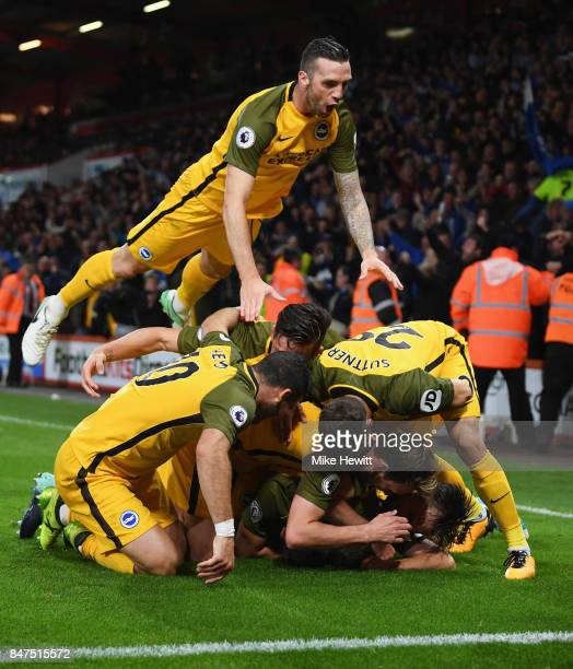 Shane Duffy of Brighton and Hove Albion joins team mates as they congratulate Solly March of Brighton and Hove Albion as he scores their first goal...