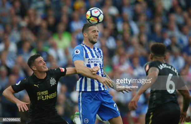 Shane Duffy of Brighton and Hove Albion jumps between Ciaran Clark and Jamaal Lascelles of Newcastle United during the Premier League match between...