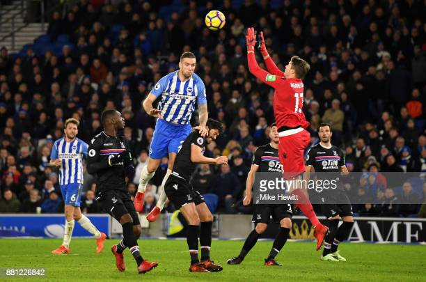 Shane Duffy of Brighton and Hove Albion jumps with Wayne Hennessey of Crystal Palace during the Premier League match between Brighton and Hove Albion...