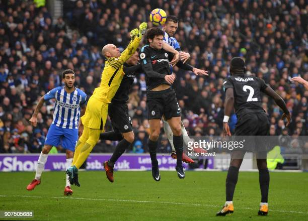 Shane Duffy of Brighton and Hove Albion jumps with Willy Caballero and Marcos Alonso of Chelsea during the Premier League match between Brighton and...