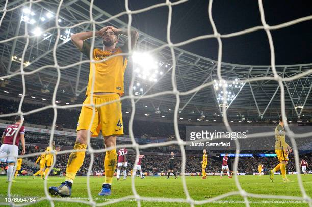 Shane Duffy of Brighton and Hove Albion looks dejected as Marko Arnautovic of West Ham United celebrates after scoring his team's second goal during...