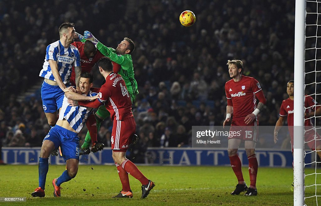 Shane Duffy of Brighton and Hove Albion (R) outjumps goalkeeper Allan McGregor of Cardiff City, but heads wide during the Sky Bet Championship match between Brighton & Hove Albion and Cardiff City at Amex Stadium on January 24, 2017 in Brighton, England.