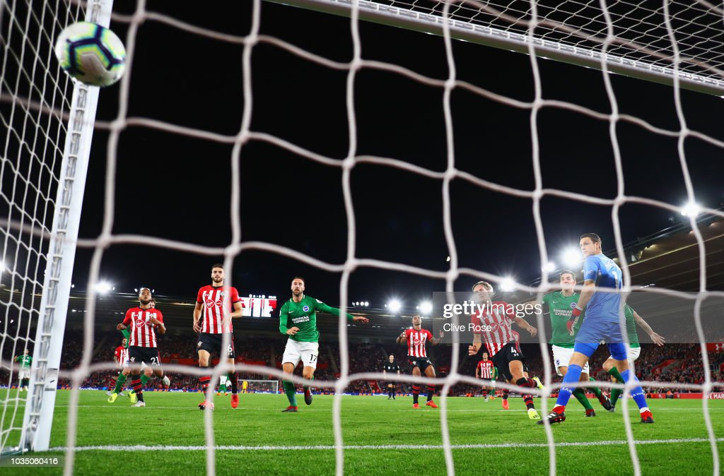 Shane Duffy of Brighton and Hove Albion (obscured) scores his team's first goal past Alex McCarthy of Southampton during the Premier League match between Southampton and Brighton & Hove Albion at St Mary's Stadium on September 17, 2018 in Southampton, United Kingdom.