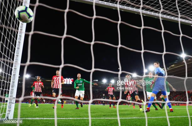 Shane Duffy of Brighton and Hove Albion scores his team's first goal past Alex McCarthy of Southampton during the Premier League match between...