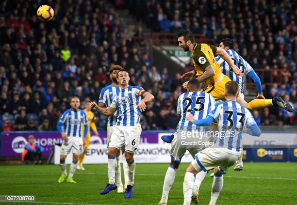 Shane Duffy of Brighton and Hove Albion scores his team's first goal during the Premier League match between Huddersfield Town and Brighton Hove...
