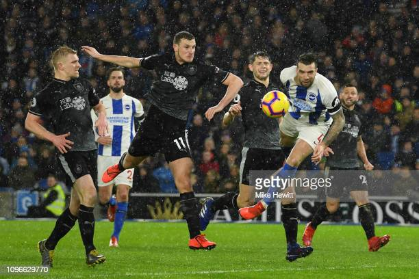 Shane Duffy of Brighton and Hove Albion scores his team's first goal during the Premier League match between Brighton & Hove Albion and Burnley FC at...