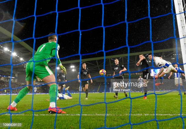 Shane Duffy of Brighton and Hove Albion scores his team's first goal past Thomas Heaton of Burnley during the Premier League match between Brighton...