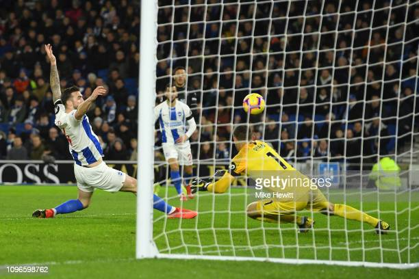 Shane Duffy of Brighton and Hove Albion stretches to block a shot which then hits the crossbar during the Premier League match between Brighton Hove...