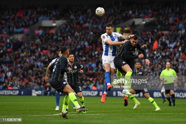 Shane Duffy of Brighton and Hove Albion wins a header over Aymeric Laporte of Manchester City during the FA Cup Semi Final match between Manchester...