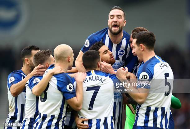 Shane Duffy of Brighton & Hove Albion celebrates with goalscorer Alireza Jahanbakhsh after the first goal during the Premier League match between...