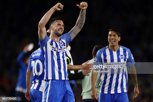 Shane Duffy of Brighton & Hove Albion celebrates with team-mates at the end of the Premier League match between Brighton and Hove Albion and...