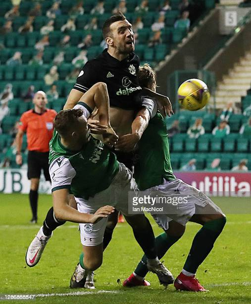Shane Duffy of Celtic vies with Ryan Porteous and Seam Mackie of Hibernian during the Ladbrokes Scottish Premiership match between Hibernian and...