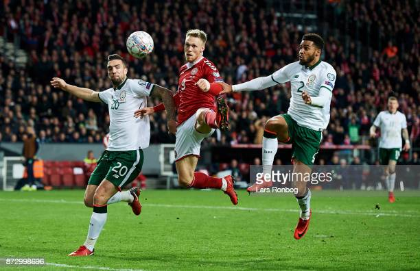 Shane Duffy of Republic of Ireland Nicolai Jorgensen of Denmark and Cyrus Christie of Republic of Ireland compete for the ball during the FIFA 2018...