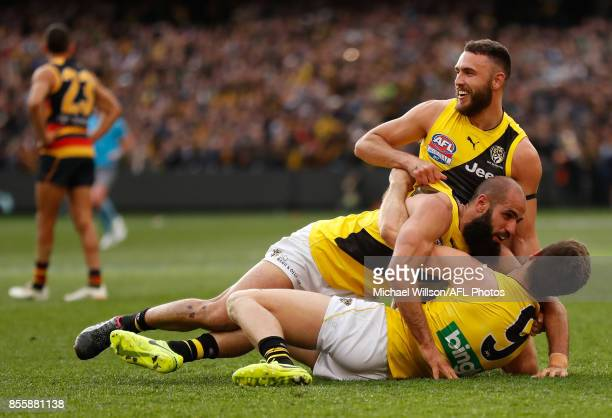 Shane Edwards Bachar Houli and Trent Cotchin of the Tigers celebrate as the final siren sounds during the 2017 Toyota AFL Grand Final match between...