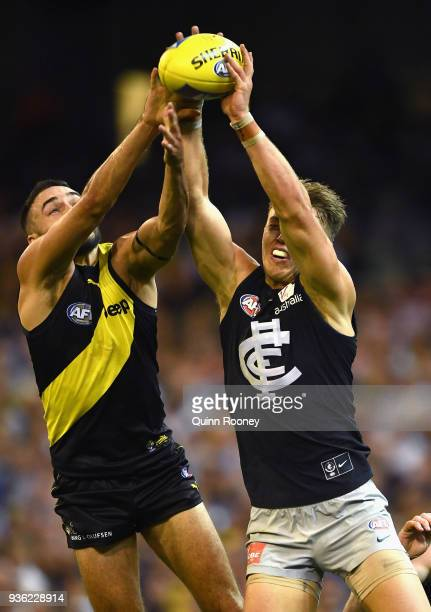 Shane Edwards of the Tigers and Patrick Cripps of the Blues compete for a mark during the round one AFL match between the Richmond Tigers and the...
