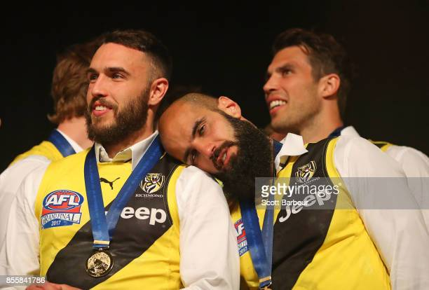 Shane Edwards of the Tigers Bachar Houli of the Tigers and Alex Rance of the Tigers look on as the Tigers celebrate with the AFL Premiership Cup on...