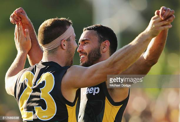 Shane Edwards of the Tigers celebrates a goal with Kane Lambert during the 2016 AFL NAB Challenge match between the Richmond Tigers and the Hawthorn...