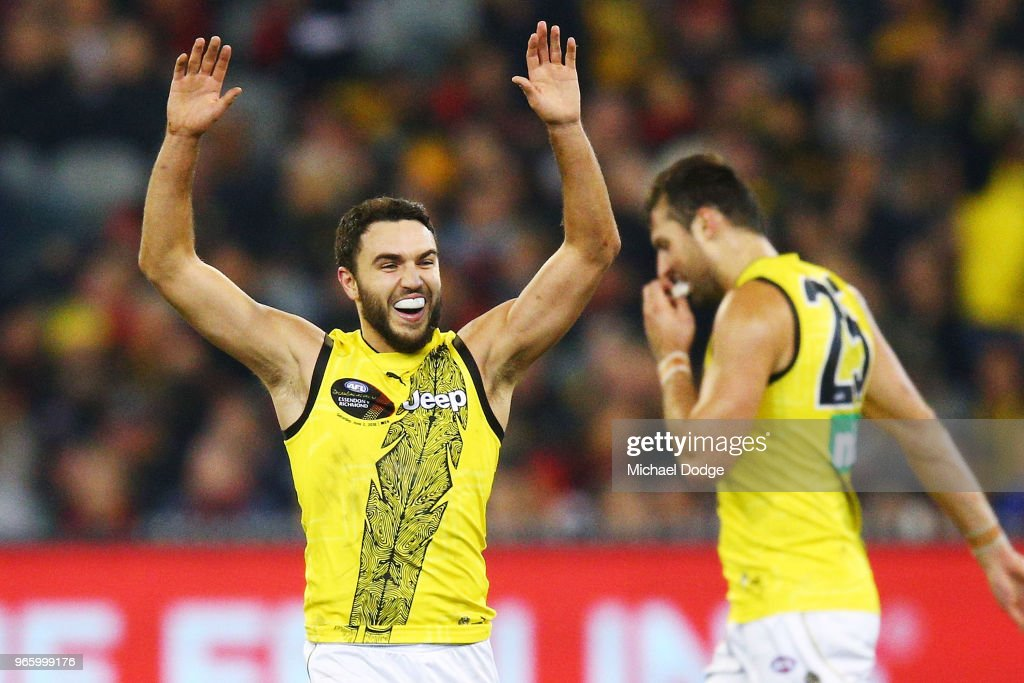 Shane Edwards of the Tigers celebrates a goal with teammates during the round 11 AFL match between the Essendon Bombers and the Richmond Tigers at Melbourne Cricket Ground on June 2, 2018 in Melbourne, Australia.